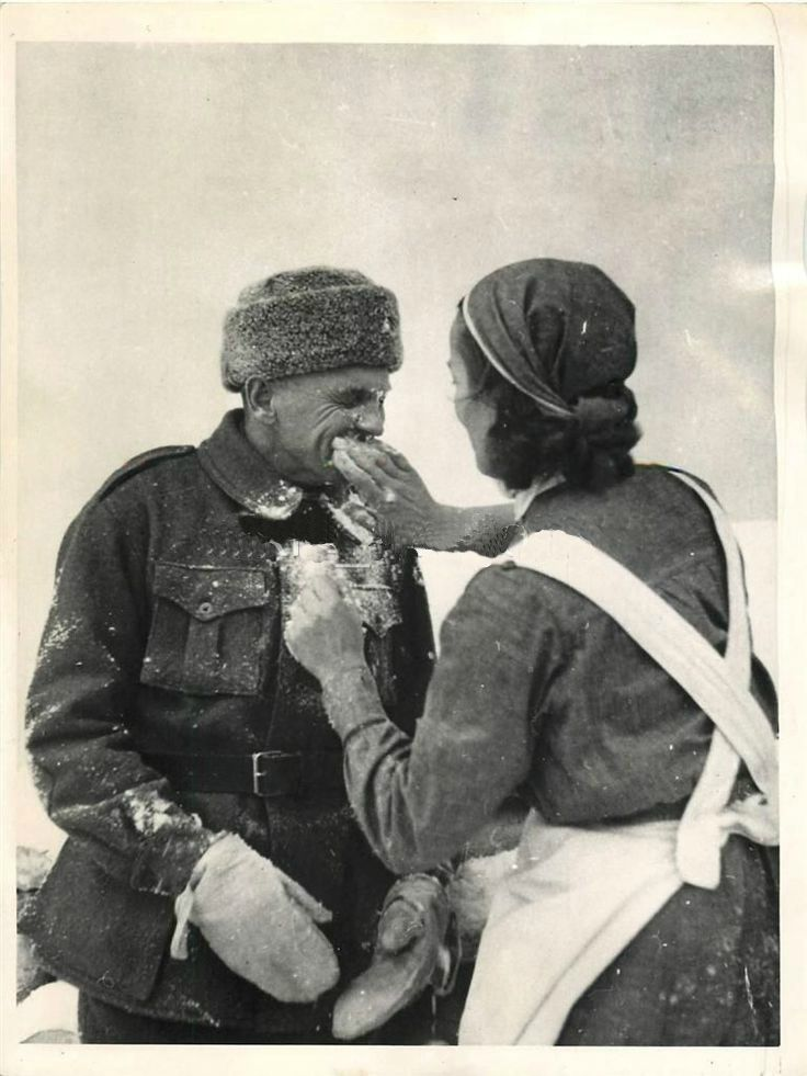 1940- Finnish nurse gives one of the first Canadian and American volunteers with the Finns his first lesson in how to keep from freezing.