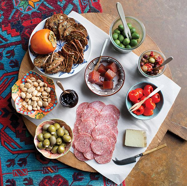 The charcuterie board held Spanish foodstuffs, like olives, almonds, quince paste, and Manchego cheese.