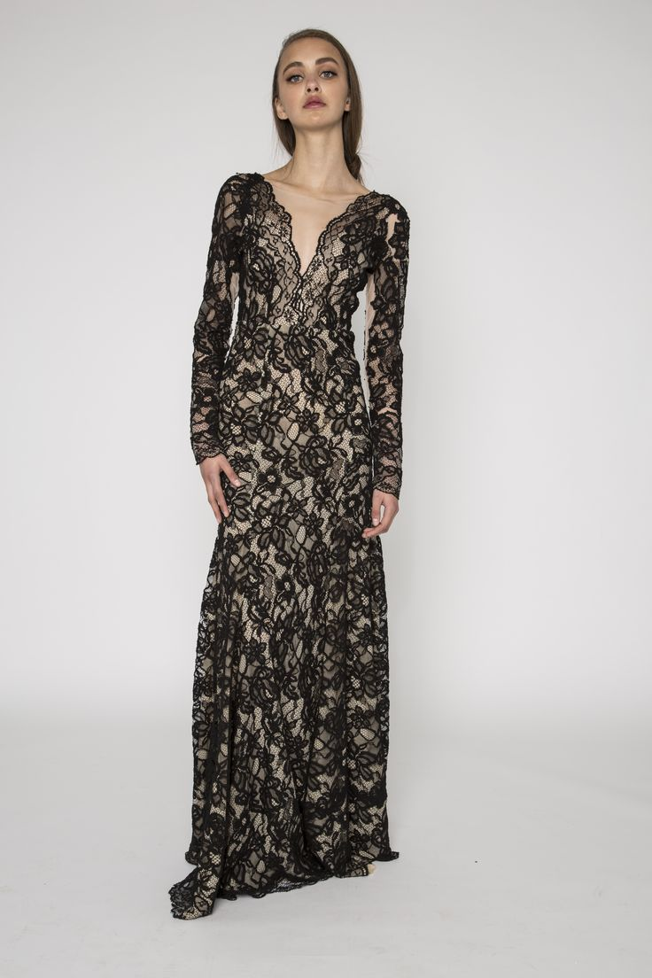 Lace embellished black gown with sleeves. The Isla dress is a black lace embellished gown. It features a deep v neckline illusion, sheer long sleeves with lace embelishments and is designed to be fitted and flare from the hips. This beautiful lace on this dress create a delicate and flowing look. #evening #floral #lace #vintage #sleeves #NARCES