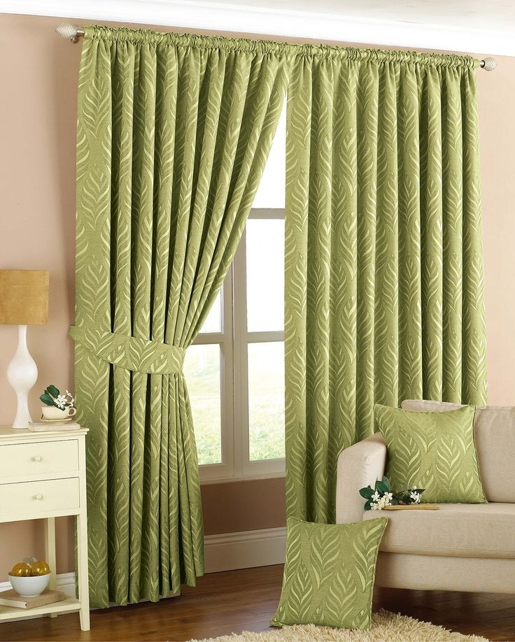 The Willow Green Pencil Pleat Curtains are a great way to make a statement in your home. They feature a contemporary geometric leaf print and are a great way to