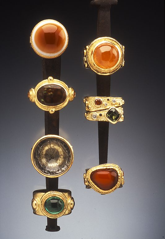18K Rings Clockwise: Agate Eye; Malayan Garnet; Tsvorite Garnet with Yellow Sapphires and Diamonds; Mexican Jelly Opal and Yellow Sapphires; 2.86ct Emerald Cabochon; Black Tourmalated Quartz Bowl; Mexican Fire Agate and Yellow Sapphires-Hughes-Bosca Jewelry | Rings