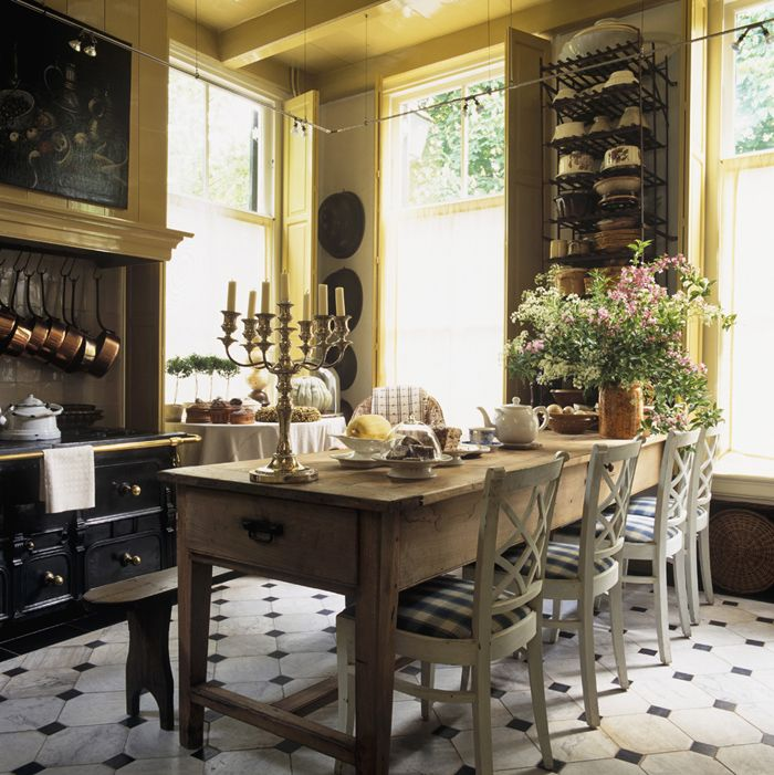 Vintage Kitchen: Beautiful rustic table, Federal style chairs, high ceiling and an amazing copper pot collection. Photo Credit: Pufik