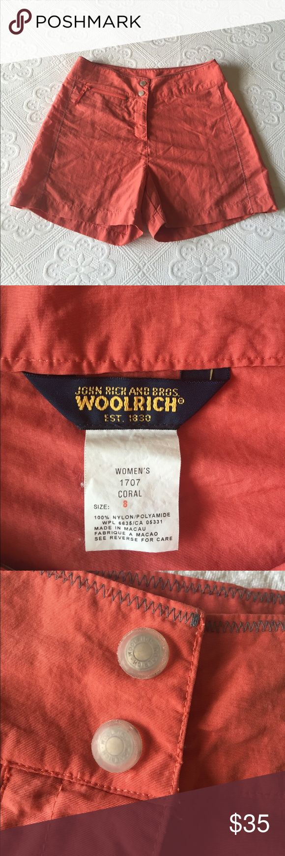 Woolrich - Coral Shorts Woolrich - Coral Shorts / Has a two snaps and a velcro fly for closure.  On the front there is a zippered pocket, deep enough to hold an iPhone 6.  Great for hiking, water sports, amusement parks, etc.  Beautiful coral color. Woolrich Shorts