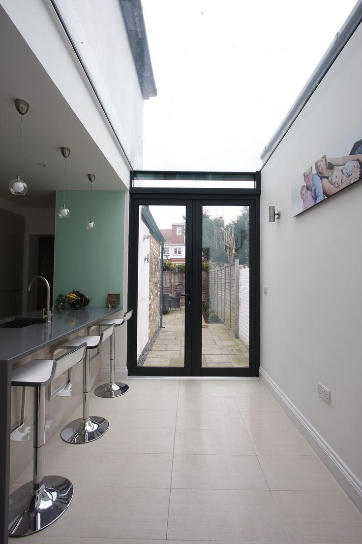 aluminium casement doors and fixed glass roof to side return extension     www.iqglassuk.com