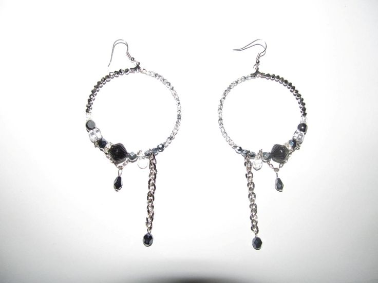 Handmade earrings (1 pair)  Made with glass beads, metals with trasparent crystals and antiallergic hoops.