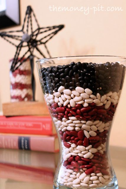 Easy and affordable way to add color and decor to a room. Place red, white and dark colored beans in an empty glass vase. #diy #patriotic #stripes #stars #americana