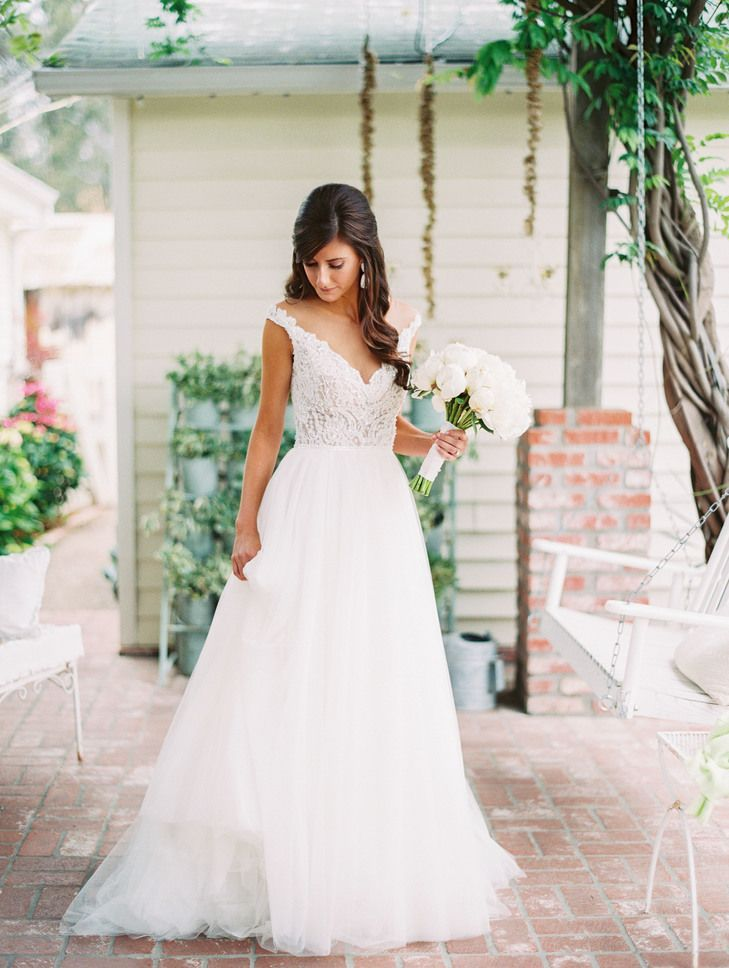Ivory Lace V-Neck Watters Wedding Dress | Dress – Watters | Hair + Makeup – Faces A La Mode | Bouquet – Flowers To You by Jessica https://www.theknot.com/marketplace/flowers-to-you-by-jessica-arroyo-grande-ca-324323 | Mirelle Carmichael Photography https://www.theknot.com/marketplace/mirelle-carmichael-photography-san-diego-ca-566041 | Lovelyfest Event Design https://www.theknot.com/marketplace/lovelyfest-event-design-san-luis-obispo-ca-757091 | The Gardens at Peacock Farms – Arroyo Grande…