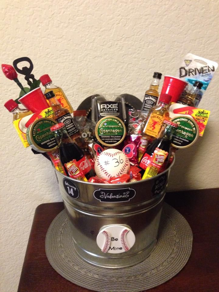 I made this for my boyfriend for Valentines Day! It's a man bouquet that I personalized for him! I looked at many before making my perfect present. And he LOVED it! -six mini alcohol bottles -three tobacco cans -two shot glasses  -air freshener -bottle opener -two packs of gum -two cokes -three bags of candy -a pocket shot -see's marshmallow heart -house slippers -axe body scrubber(awesome)! -heart baseball -chocolate rose most of this is from target!