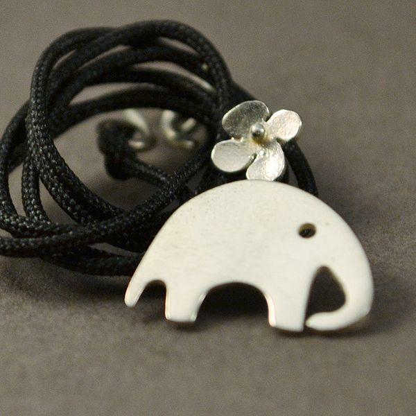 Silver necklace in the shape of small elephant. The small elephant is:  1,8x1,5cm (0.70x0.59) inc. The length is about 23cm (9.06 inc). The clasp is silver.  All our deliveries are done by  the Greek Postal Service and registered.