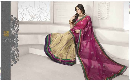 Net Lengha saree in off white and magenta, The Saree is in a lovely soft net in a beautiful magenta and offwhite shaded combination fabric with a multicoloured border all the way along the saree.  £139.99