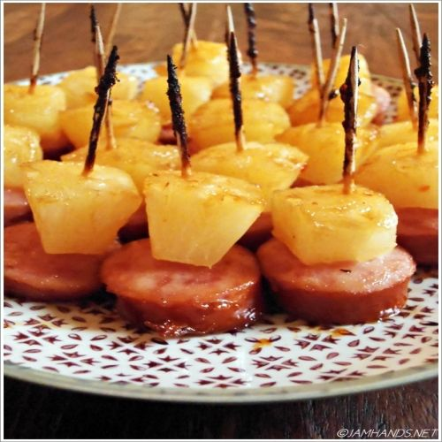 Glazed Pineapple Kielbasa Honey Bites,Directions:     1. Preheat oven to 425-f degrees. Line a baking sheet with parchment paper.      2. Place a piece of pineapple on top of a slice of kielbasa and stick a toothpick into them.      3. In a small bowl combine remaining ingredients. Place kielbasa bites onto the baking sheet and brush glaze over tops and sides of bites.      4. Bake for 15 to 20 minutes until hot. Let cool slightly and serve warm.