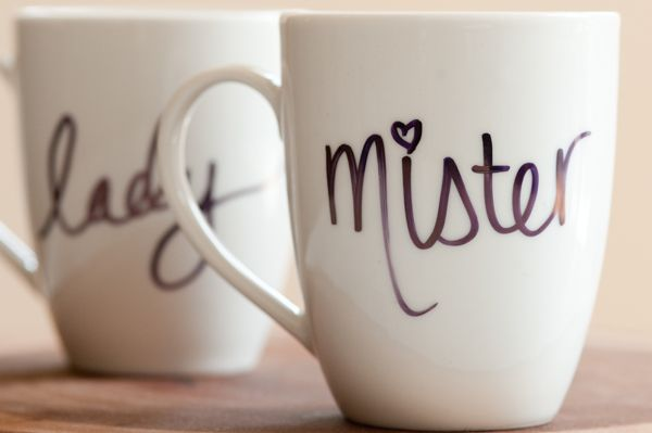 #DiyChristmasGifts -- DIY Sharpie mugs- Buy your mugs from the dollar store, use a sharpie to write whatever you would like and then bake at 350 for 30 minutes and it becomes permanent.  Mr. & Mrs. :)