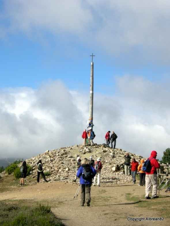 Cruz de Ferro, Camino de Santiago. This is where we pilgrims leave our stone from home, and let go of the stuff that weighs us down..