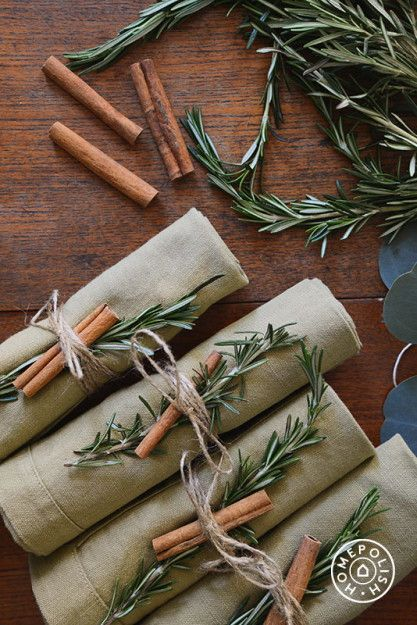Cinnamon, Evergreen and Twine Napkin Rings — use cinnamon sticks and evergreen twigs to make these gorgeous Twine Napkin Rings. The rolled linen napkins look lovely when combined with seasonal clippings. #napkinrings