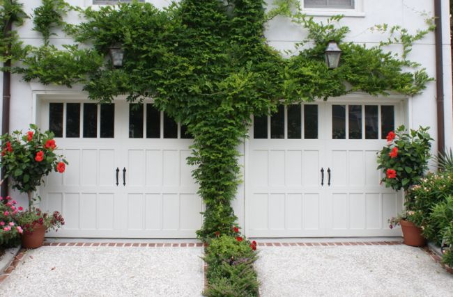 Garage Door Covered With Green Plants And Upwards Flanking
