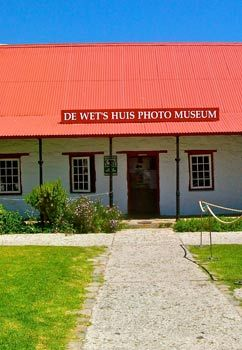 De Wet's Photo Museum in Hermanus - In 1983, the old Dutch Reform Sunday School was dismantled by the museum staff and moved to Fisherman's Village, where it was rebuilt (stone for stone and using the very same timber).