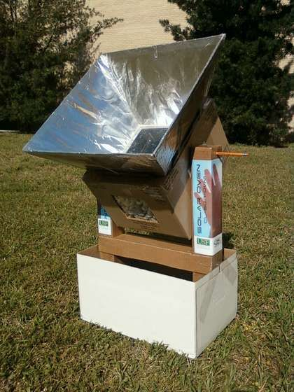 Solar Oven Instructions.  Rocker keeps food upright while collectors can follow the sun.