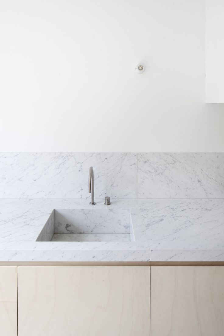 Marble kitchen countertop. House VV by Rolies + Dubois.