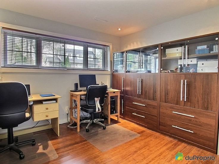 Super bright basement office with bamboo floors. You can fit so much in this wall unit!
