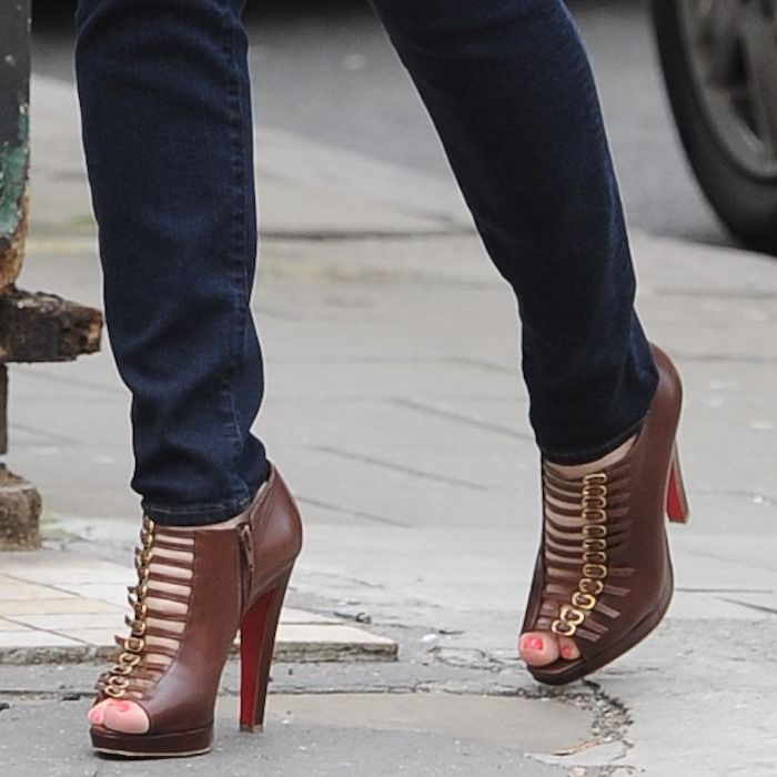 Kelly Brook wearing brown leather buckled Christian Louboutin 'Manon' booties