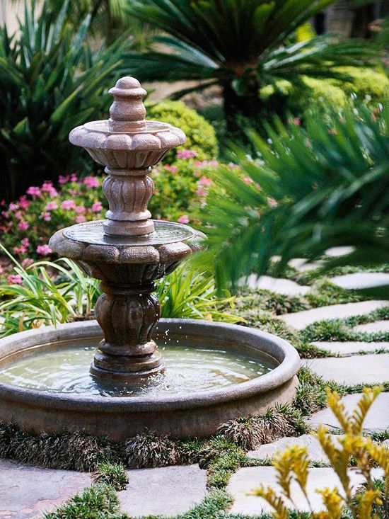 Like this classic fountain with paving stones and plants