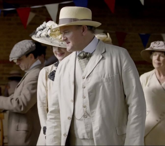 Downton Abbey - Hugh Bonneville in Panama Suit  Linen with Albert watch chain and Ascot. Note how the vest is cut straight at the bottom and the lower button remains undone.Also the Panama hat has a special shape and light brown ribbon.