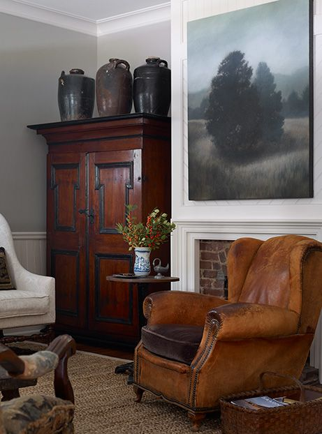 Photo Credit: Emily Followill. A leather and velvet reading chair grounds the living room.