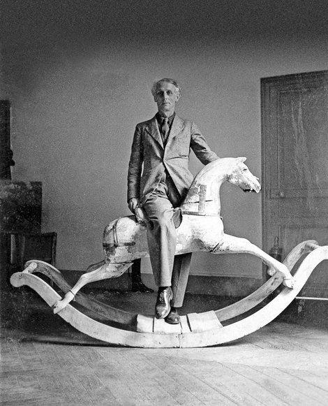 Max Ernst with rocking horse, Paris by Max Ernst