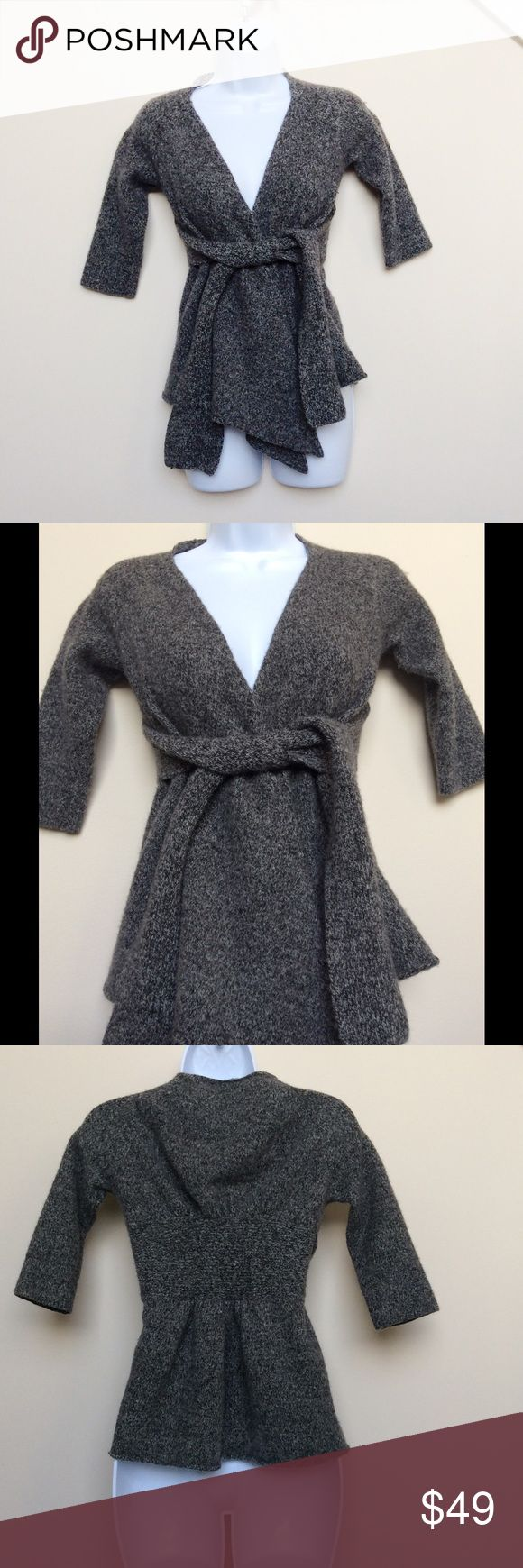Anthropologie Grey Long Cardigan with Tie Closure You will surely be warm and cozy in this lovely grey long cardigan from Canary brand for Anthropologie.  Size XS.  Cardigan is has marled grey pattern and features tie closure, 3/4 length sleeves, and is slightly cinched at waist for a flattering figure profile.  Item is in excellent used condition.  Material content is 89% wool (very warm!), 10% nylon, 1% spandex. Anthropologie Sweaters Cardigans