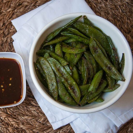 Crisp, tasty roasted sugar snap peas are the perfect savory snack to satisfy that salty craving in a healthy way.
