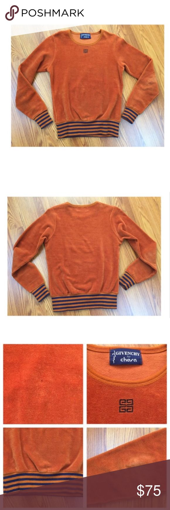 Vintage Givenchy Orange Form Fitting Sweater Super stylish burnt orange / amber color sweater top by Givenchy circa the 1970s.  Soft, velour like material with stretch.  Banded cuffs and waist band with blue stripes.  Givenchy logo on front below neckline.  Small discoloration on material on front - does not take away from the cool factor of the top. Some slight fading in the elbows, stretch, and pilling from age, wear, and storage.  Otherwise, great vintage condition!  No size or material…