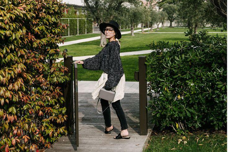 J.W.Anderson Sweater and Skirt, R13 Denim, Dear Frances Sandals, Loewe Sunglasses, Mark Cross Bag, Janessa Leone Hat via @eggcanvas