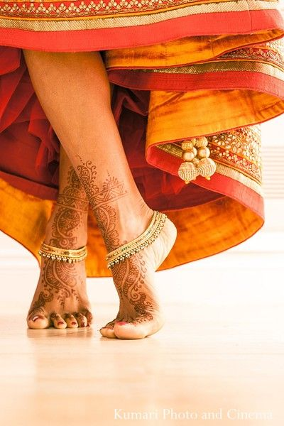 This Indian bride prepares for her fabulous wedding ceremony. Good pose for Mehendi ceremony