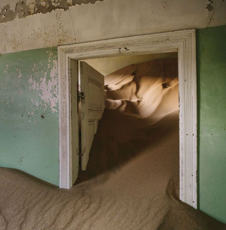 Kolmanskop, a town in Nambia that has been relinquished to the desert. A favourite of photographers, the once wealthy German mining town is said to have been abandoned in the mid-1950s, its ornate houses and ballrooms giving way to sand that curves around doors and walls.