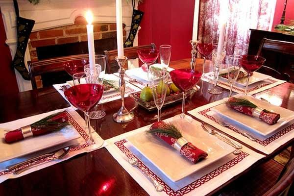 A gorgeous wooden table is something I hate to see hidden. I love how Wendy keeps her table simple, yet classic with her square placemats, everyday plates and a festive napkin setting. The addition of not one, but two sets of tapered candles add a special formality to the Christmas look. Such a simple, well designed setting anyone can recreate!