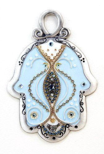 Handmade Baby Blue Home Decor Wall Hanging Hamsa Hand for Luck by Most Original Gifts & Jewelry. $69.00. Designed with Swarovski crystals, brass and copper accents. The Hamsa Hand is believed to protect the home from strangers. Decorative handmade hanging Hamsa from Pewter. Hand painted and signed by the artist. The Hamsa is 12.5 cm (4.9 in) length, 8 cm (3.1 in) width. Decorative hanging Hamsa from Pewter. Designed with Swarovski crystals, brass and copper accents.  The Hamsa is...