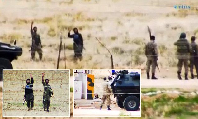 Shocking video shows ISIS fighters chatting with Turkish border guards