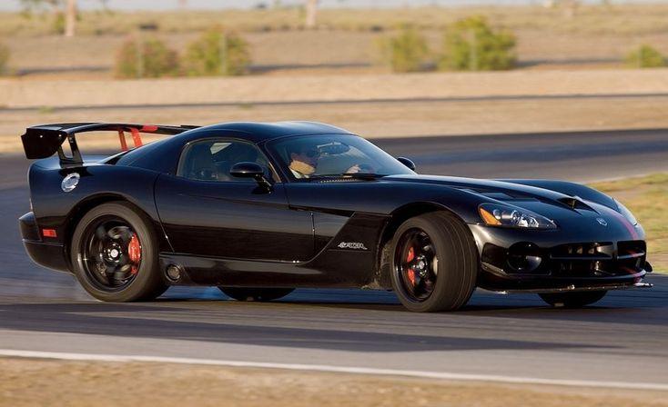 """2008 Dodge Viper SRT10 ACR Dodge isn't being coy. """"Complete a high-performance driving school prior to operating this vehicle,"""" demands the separate 24-page owner's manual on theACR'sspecial features. """"Competitive driving and track outings can cause serious injuries or death.""""  HIGHS  Racing suspension, tires, and brakes; Darth Vader styling; 600 horses."""