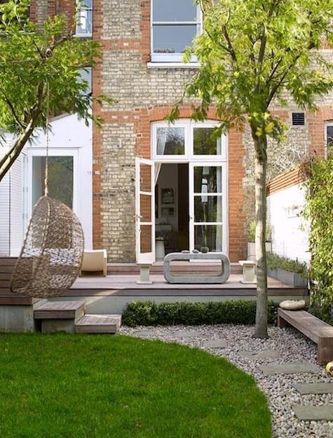 English town garden with hanging egg chair and modern coffee table | adamchristopherdesign.co.uk