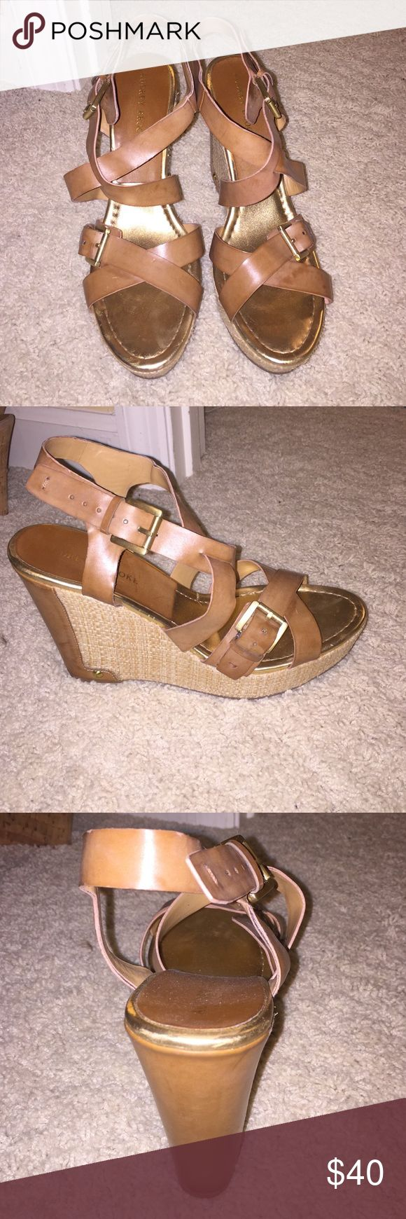 Audrey Brooke wedges tan wedges with gold buckles and detailing. back of the heel is detailed with leather and the rest of the wedge is woven. women's size 10, but do run a little small (im usually a 9-9.5 and they fit me) only worn a few times, super cute shoes that go great with any outfit! Audrey Brooke Shoes Wedges