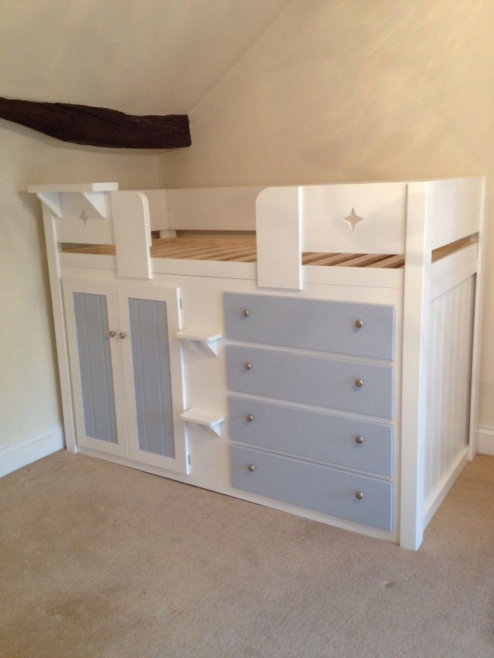 Childrens four drawer cabin bed in white and sky blue with star cut outs  and clip