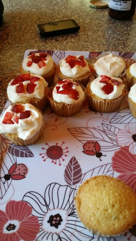 Vanilla Cupcakes. Centre filled with strawberry jam and topped with cream and strawberries. Tasty!!