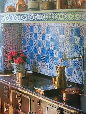 Claude Monet's blue & white kitchen with copper pots at Giverny, France.