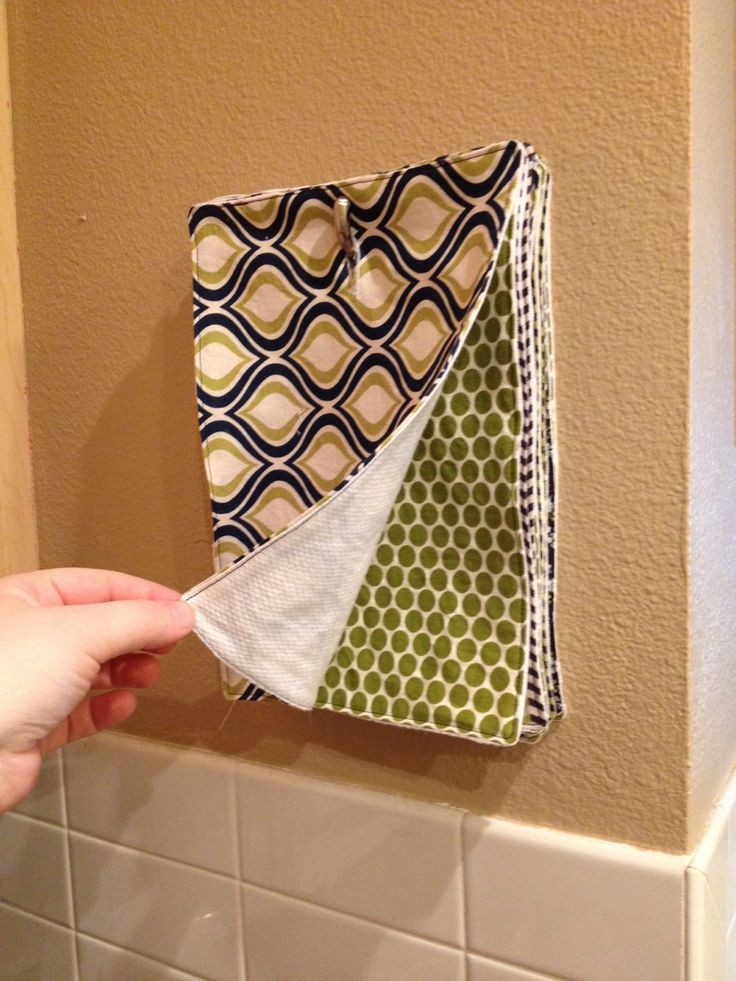 I wonder if hanging our cloths like this will help my husband reach for them over paper towel. diy-reusable-kitchen-towels