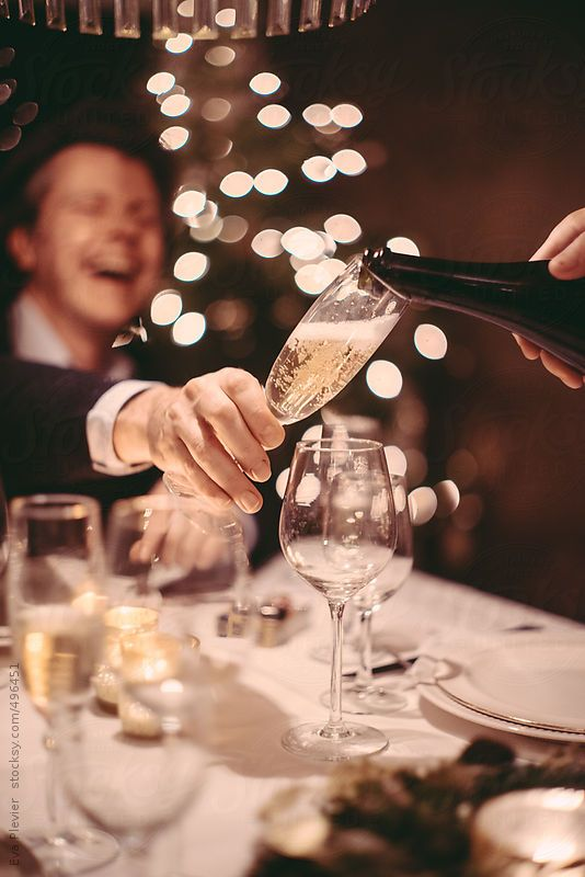 Serving champagne in a cozy christmas dinner with family and friends  by  Eva Plevier   Stocksy United   Royalty Free Stock Photos. 57 best Christmas images on Pinterest   Stock photos  Gifts and Noel