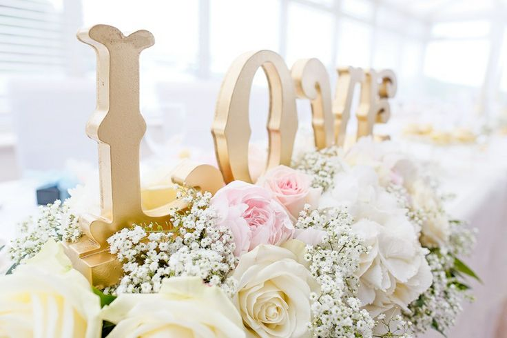 Gold love sign for wedding top table