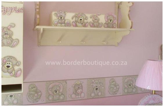 2 tone pink scruffy jungle nursery decor with cream sanded accessories.