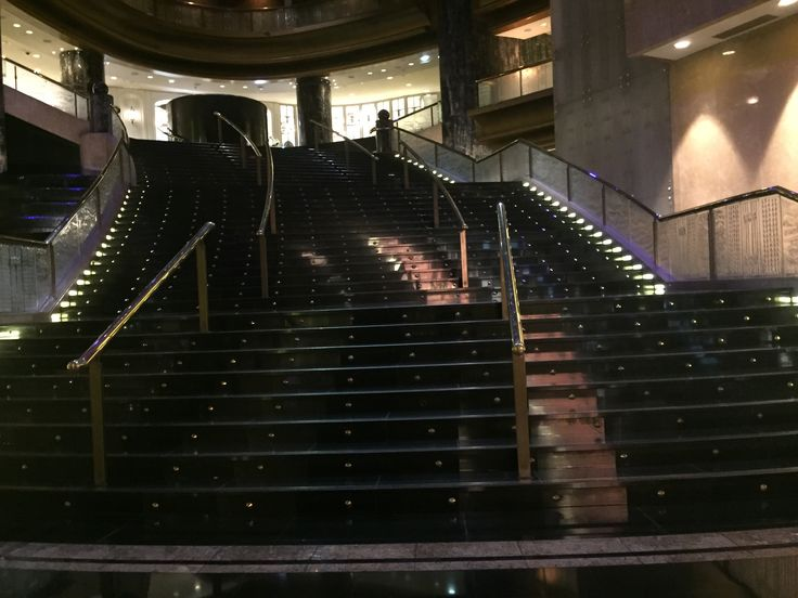 PHOTO SIX CROWN LOBBY : A large marble stair case locate in the crown lobby, this is where many Australian awards are held. The use of the material marble helps to create  a expensive interior which creates a feeling of wealth and luxury, which is what crown is all about.