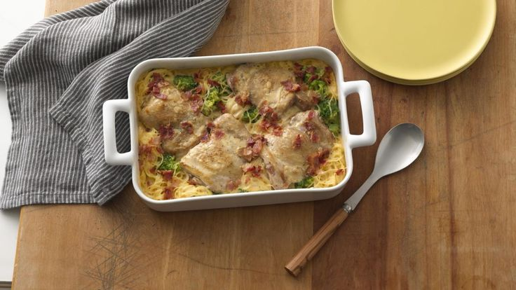Smothered Chicken Casserole recipe and reviews - Enjoy this creamy chicken casserole baked with chicken thighs, broccoli and angel hair pasta. The bacon sprinkled on top adds to the