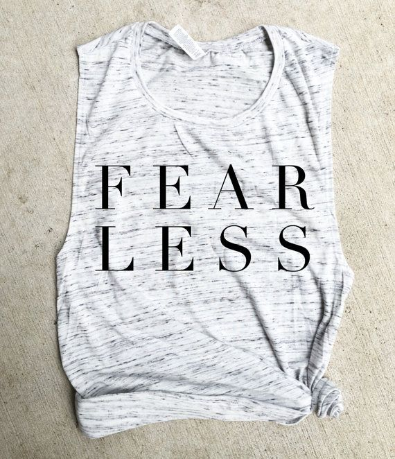 Super cool muscle tee!  I believe cute tanks are a MUST for everyones workout…